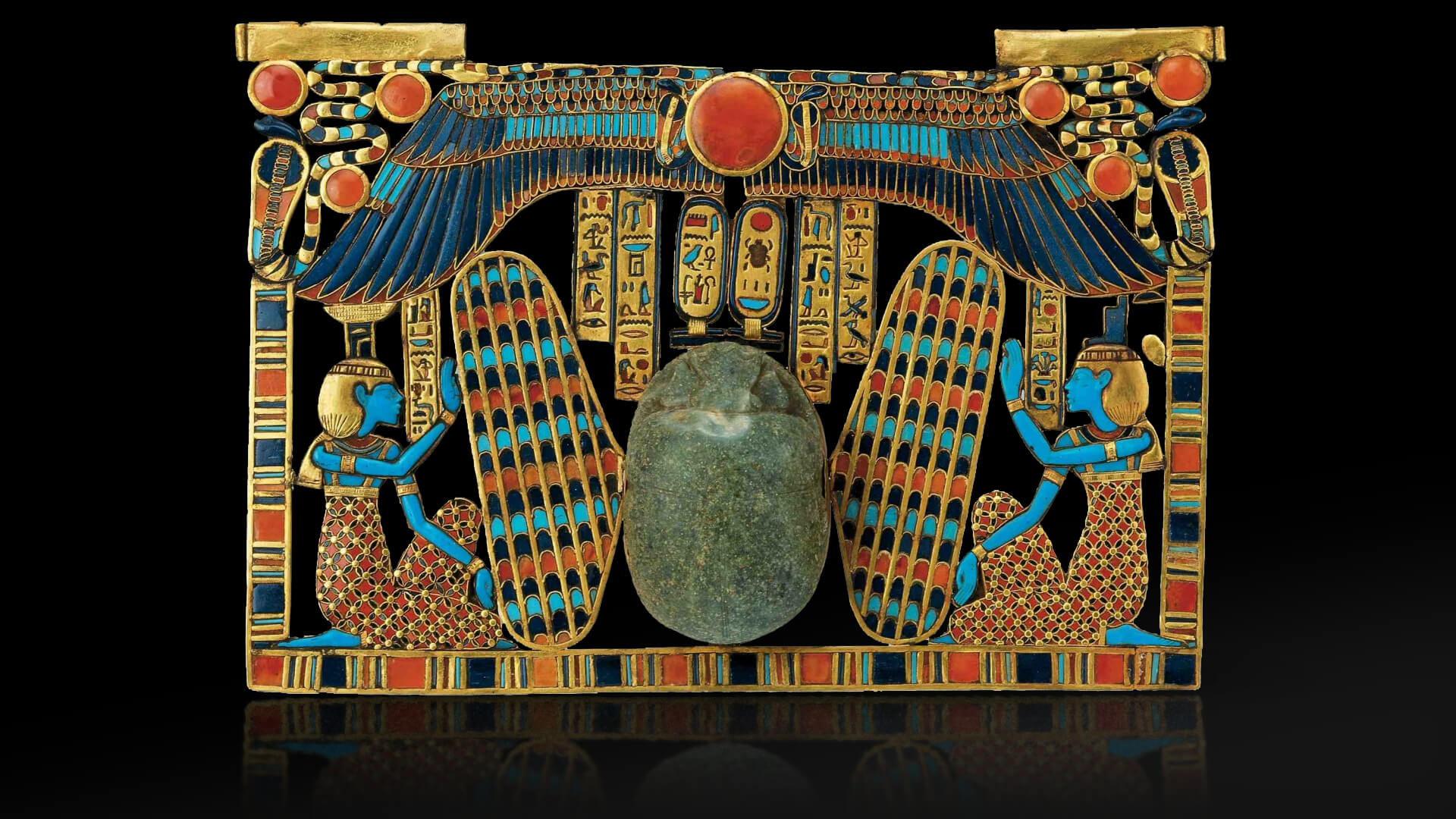 Tutankhamun. inlaid pectoral  scarab beetle with isis and nephthys