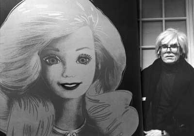Andy Warhol , With his painting, Barbie, 1986