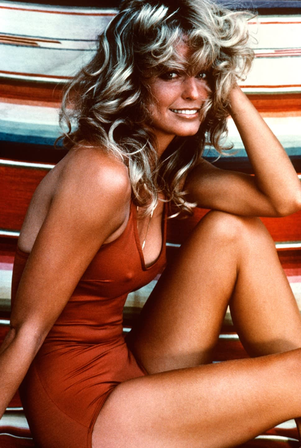 Norma Kamali , Farah Fawcett's red one-piece, shot by Bruce McBoom, 1976