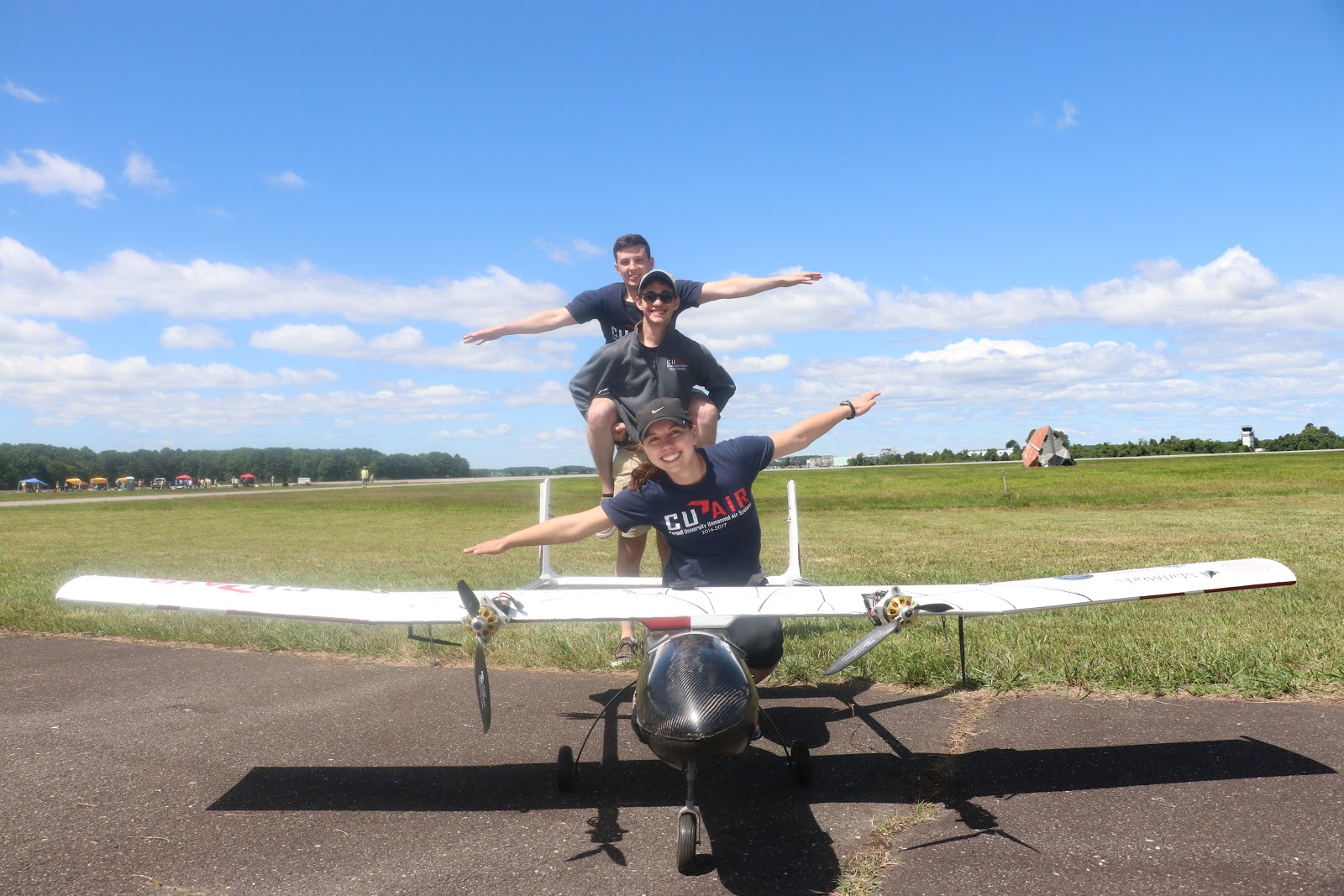 CUAir_Members of the CUAir team with their autonomous unmanned aircraft
