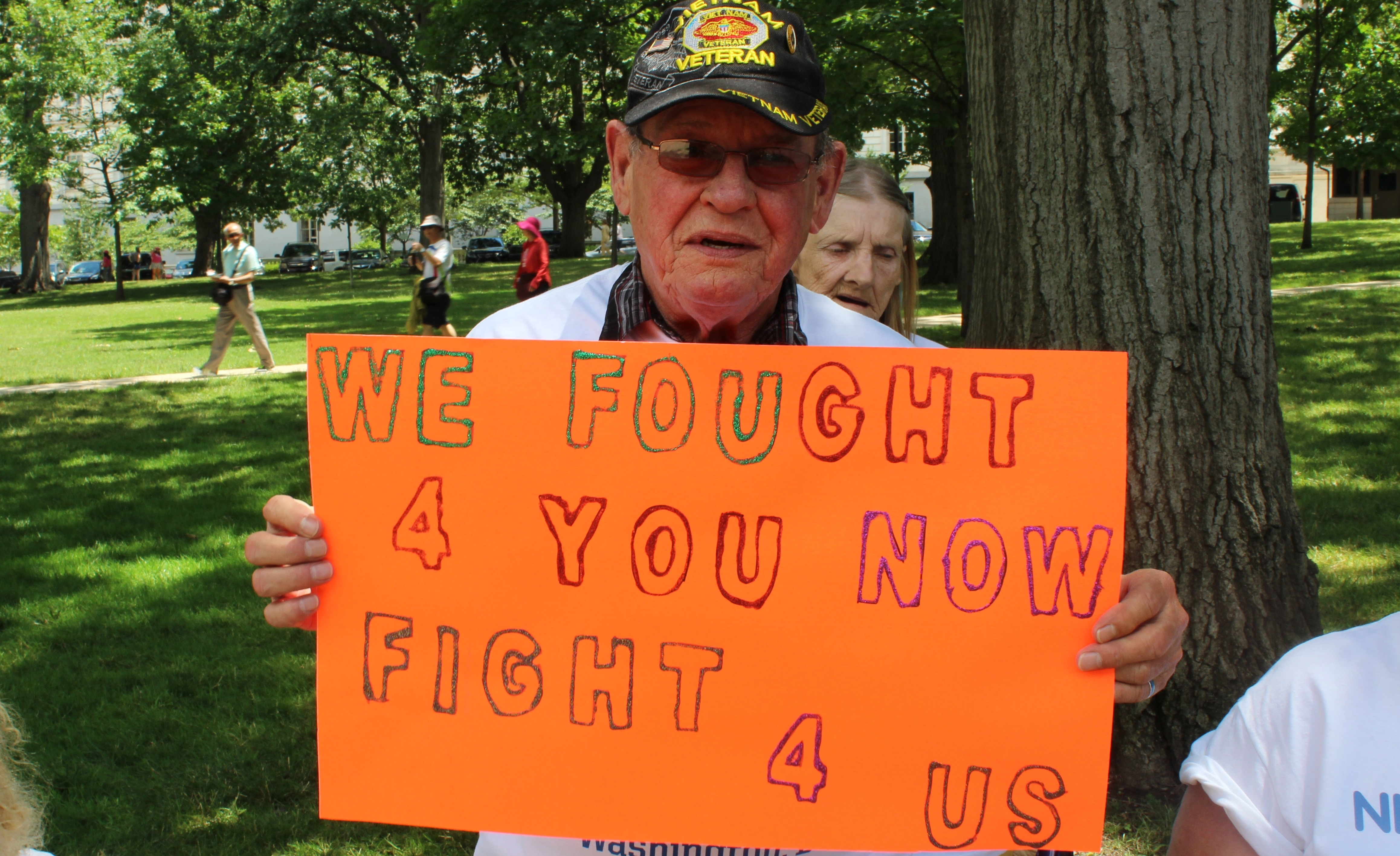 A veteran protests funding cuts to a federal affordable housing program that he relies on to live in a safe and healthy home.