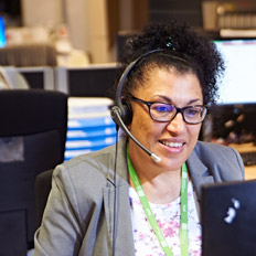 Person at desk wearing a headset