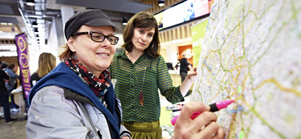 Picture of a woman highlighting a map