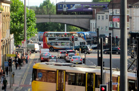 Tram bus and train crossing London Road
