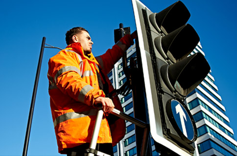 Man fixing traffic signal