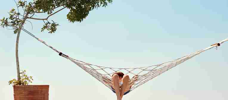 Child in hammock, on holiday with TUI