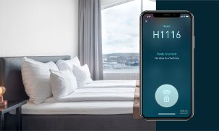 Hotel bed and app screen with mobile key