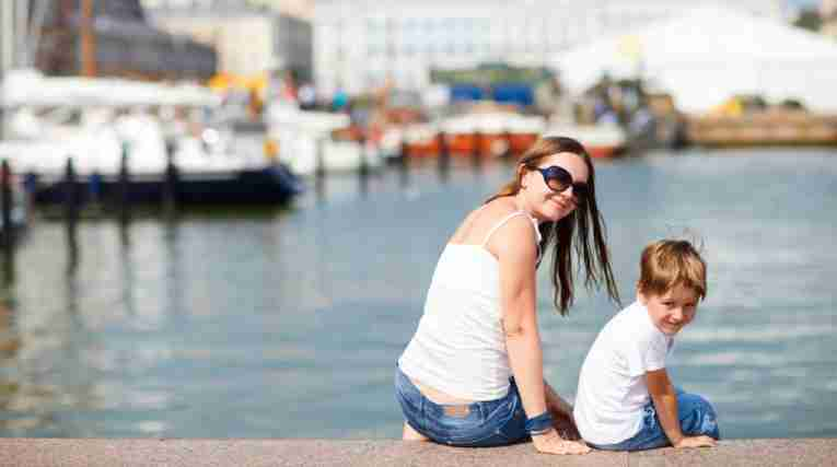 Mother and son enjoying views of city center Helsinki Finland