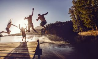 Friends jump in the water
