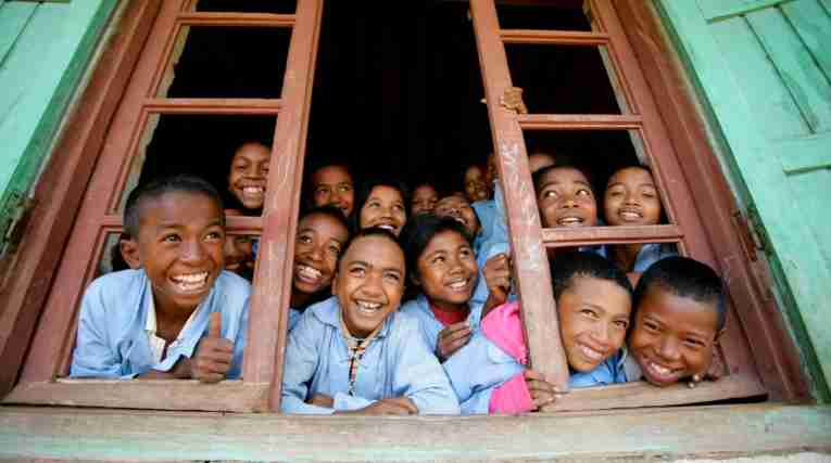 Happy kids in window UNICEF