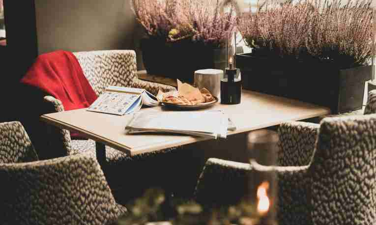 Book at a table, hygge at Clarion Collection Hotel