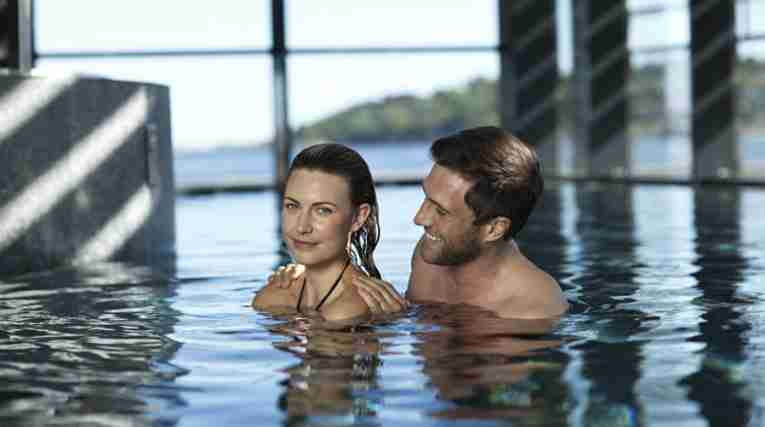 Couple in the pool in Farris Bad, Larvik