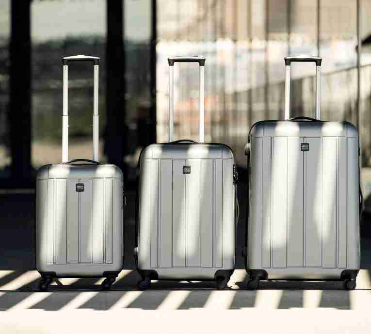 Three Accent suitcases in a row
