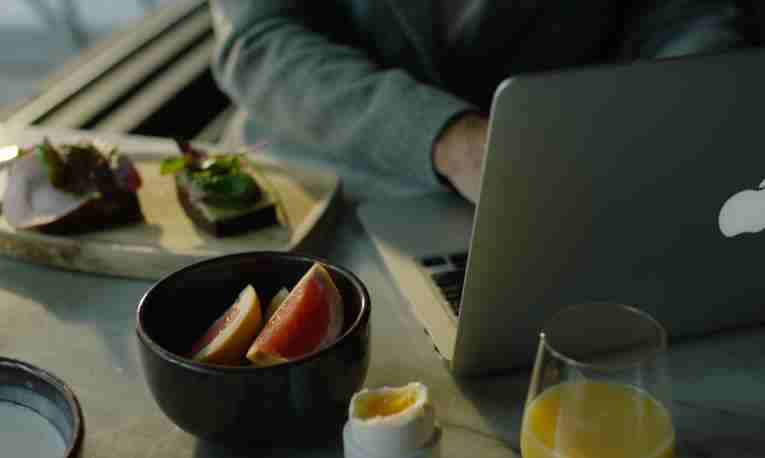 Breakfast in front of laptop