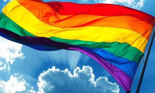 Pride flag waving in the sky