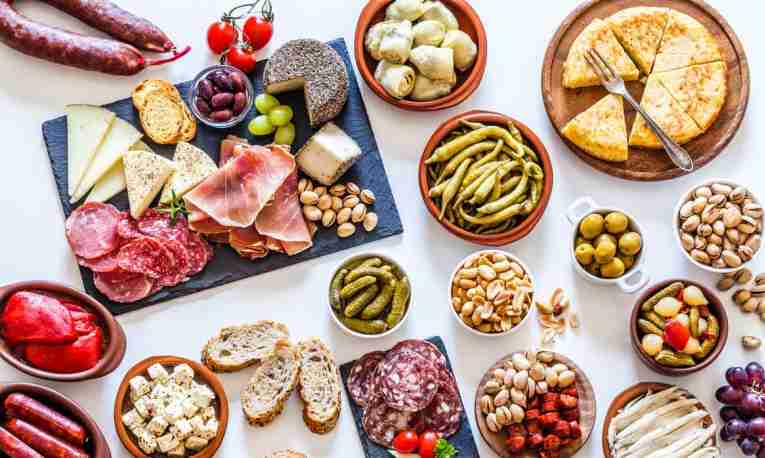Tapas food sharing platter white background