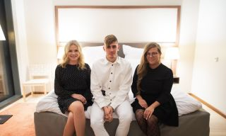 3 finnish influencers on a hotel bed
