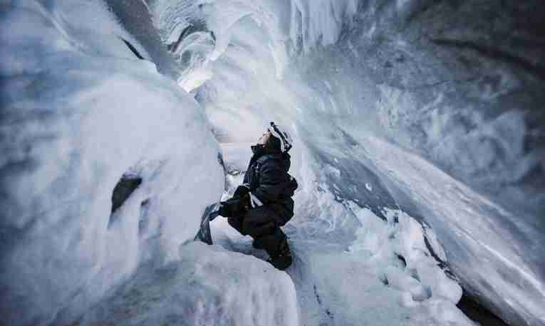 Woman in ice cave on Svalbard
