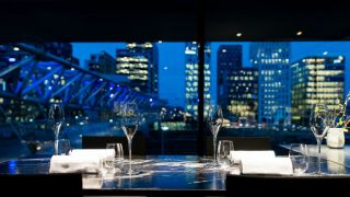 Table at Maaemo with a view over Barcode in Oslo