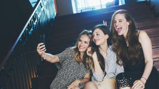 Three women taking a selfie in the stairs