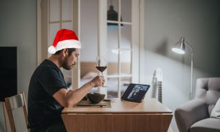 Man with santa hat on a virtual date.