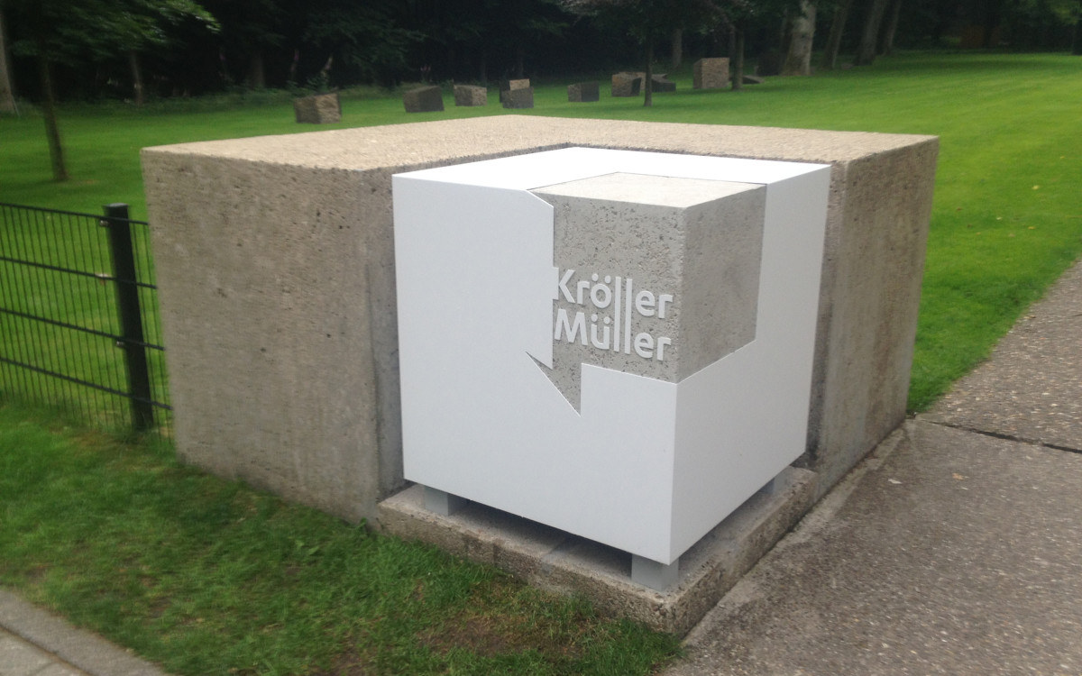 The logo in 3D which marks the entrance to the sculpture garden.