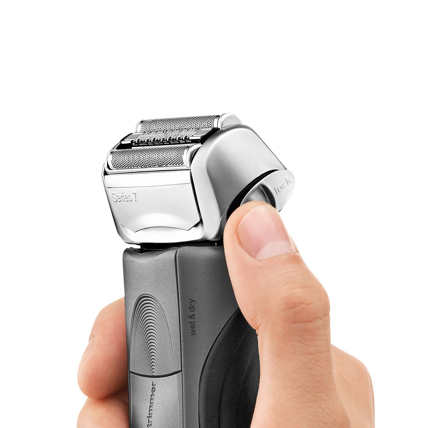 Braun Series 7 grey electric shaver in hand