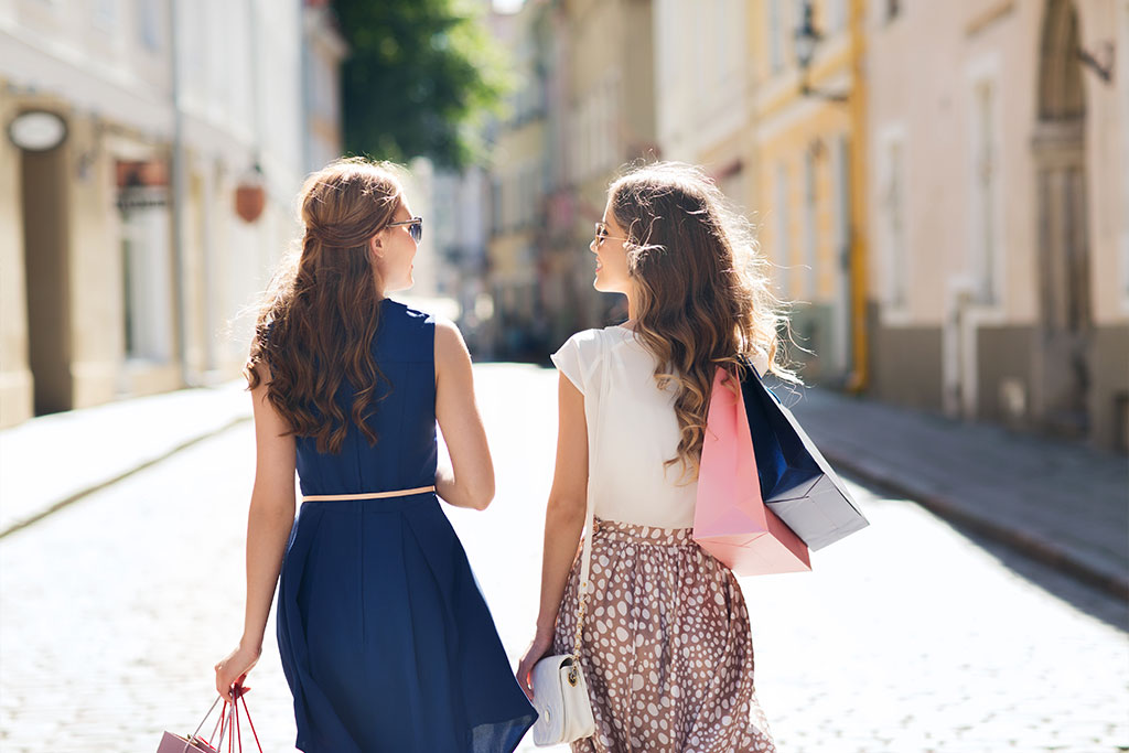 women-with-shopping-bags-walking