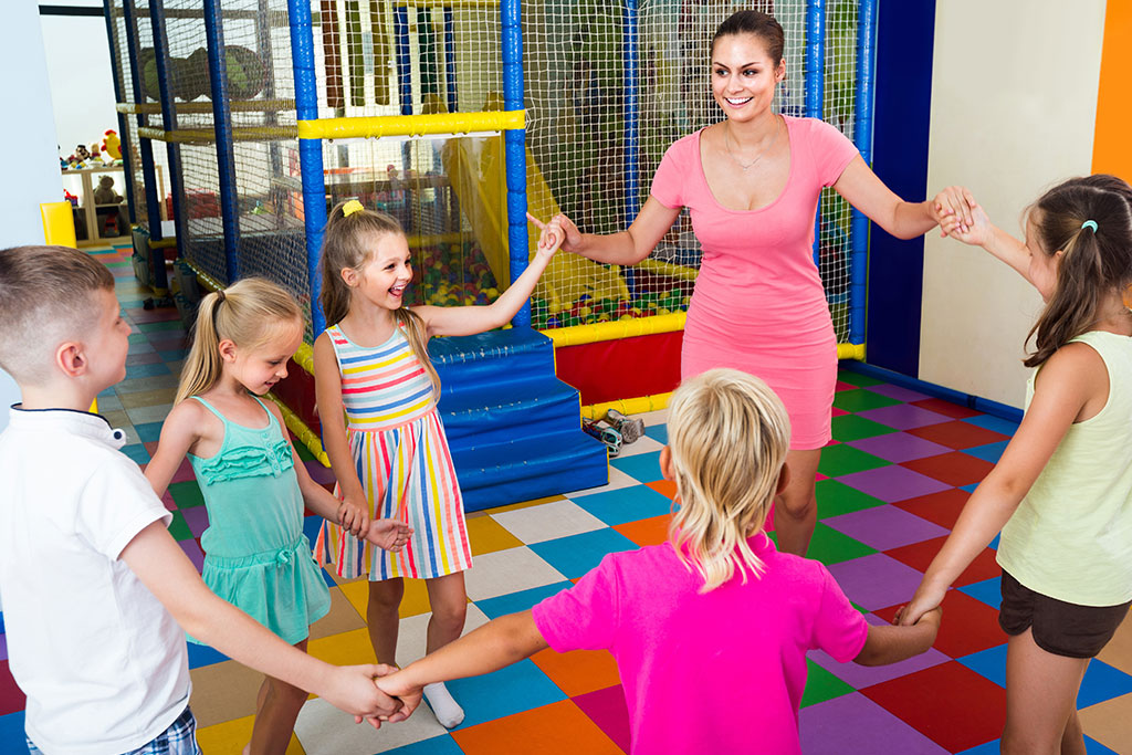 happy-children-dancing-with-teacher