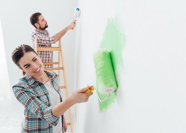 happy-couple-painting-walls