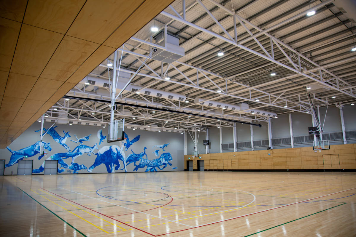 Interior view of centre, showing some courts and mural on the wall