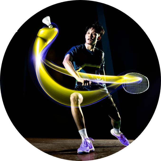 A sports man hitting a badminton stroke