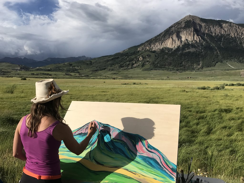 sarah painting in the mountains