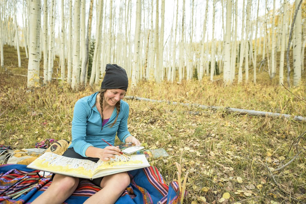 sarah painting in aspen forest