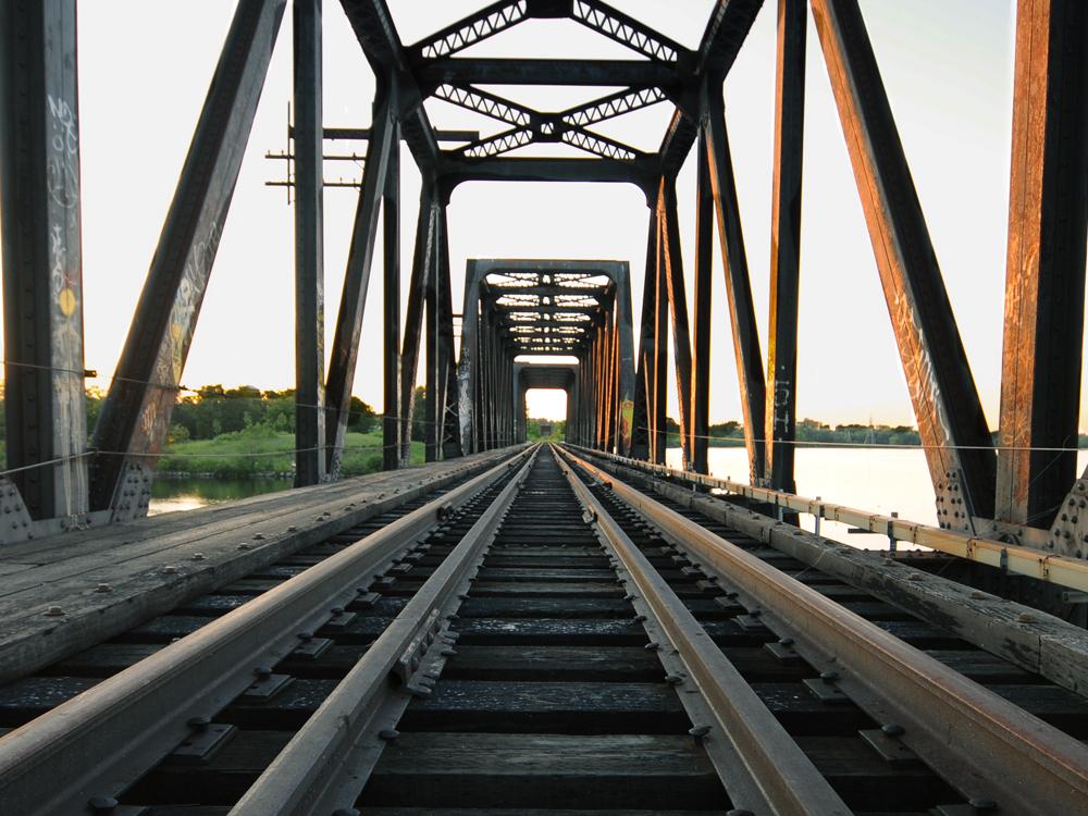 Train tracks cross a bridge.