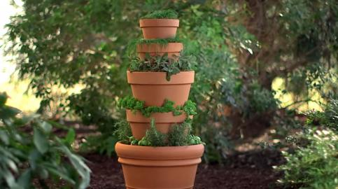 How To Make an Herb Tower Container Garden Fill a few planters with herbs that will grow to be e wel e ingre nts for delicious meals