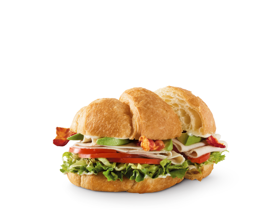 Sliced turkey breast, hardwood-smoked bacon, avocado, lettuce, tomatoes and mayo on a croissant.