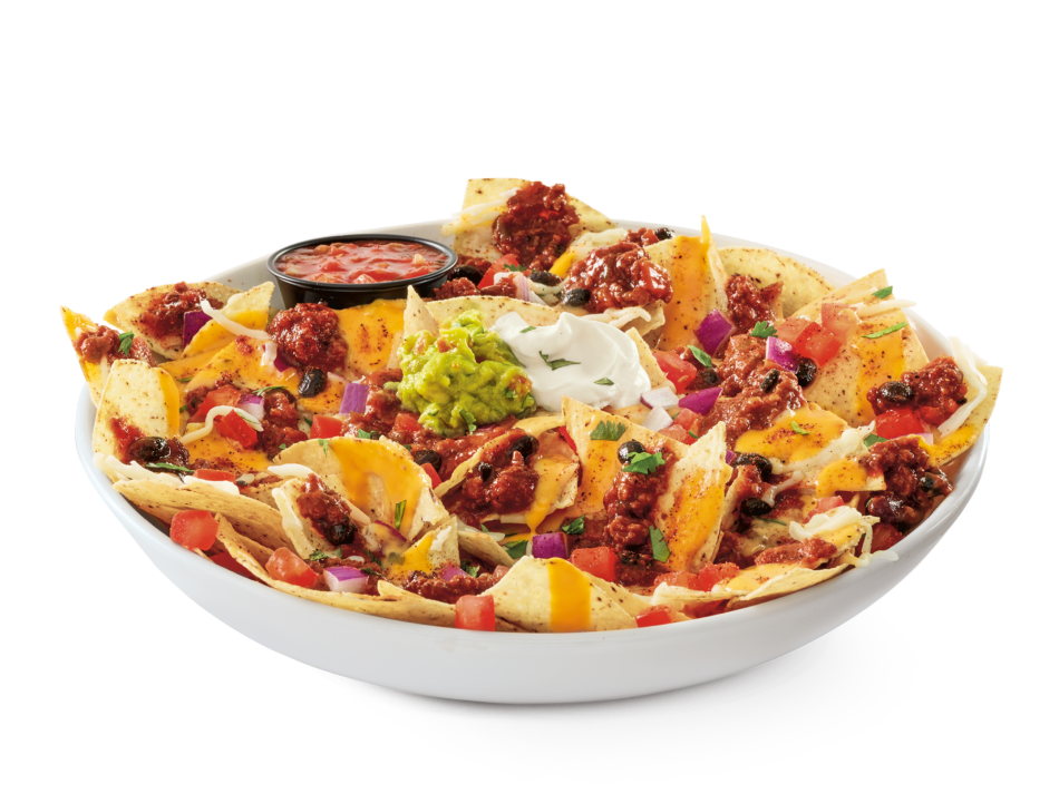 Tortilla chips topped with Red's Chili Chili™, two cheeses, guac and salsa, tomatoes, red onion, sour cream, and cilantro.