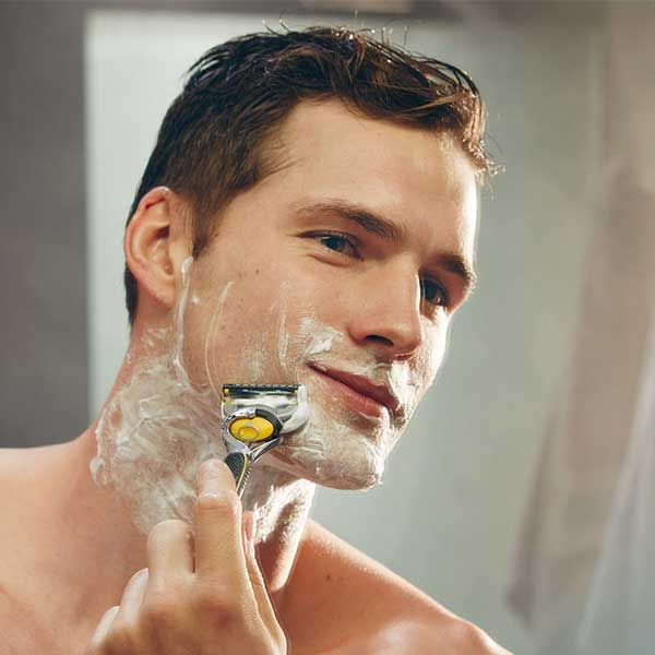 Man shaving beard