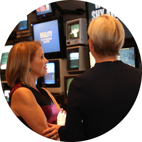 Katie Couric and Carolyn Tastad, P&G Group President North America, take in the Women at Work: Myth vs. Reality Interactive Exhibit