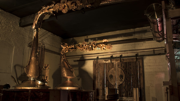Copper stills decorated with fire-breathing dragons. Photo by Juliet Frew.