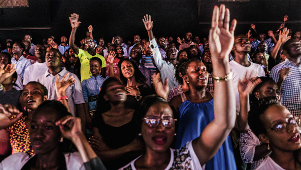 __Sunday service at Watoto, a Pentecostal megachurch in Kampala that hosted Scott Lively in 2009. Activists say Watoto, led by American pastor Gary Skinner, has been instrumental in spreading homophobia in Uganda.__