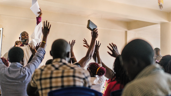 __Members and allies of the Ugandan queer community gather for a service led by gay American pastor Joseph Tolton, who makes annual visits to East Africa to mentor faith leaders in LGBTQ acceptance.__
