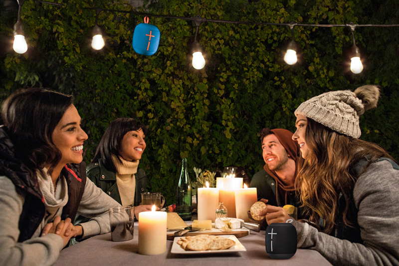 Ultimate Ears Wonderboom Speaker Hanging From a String of Lights Outside