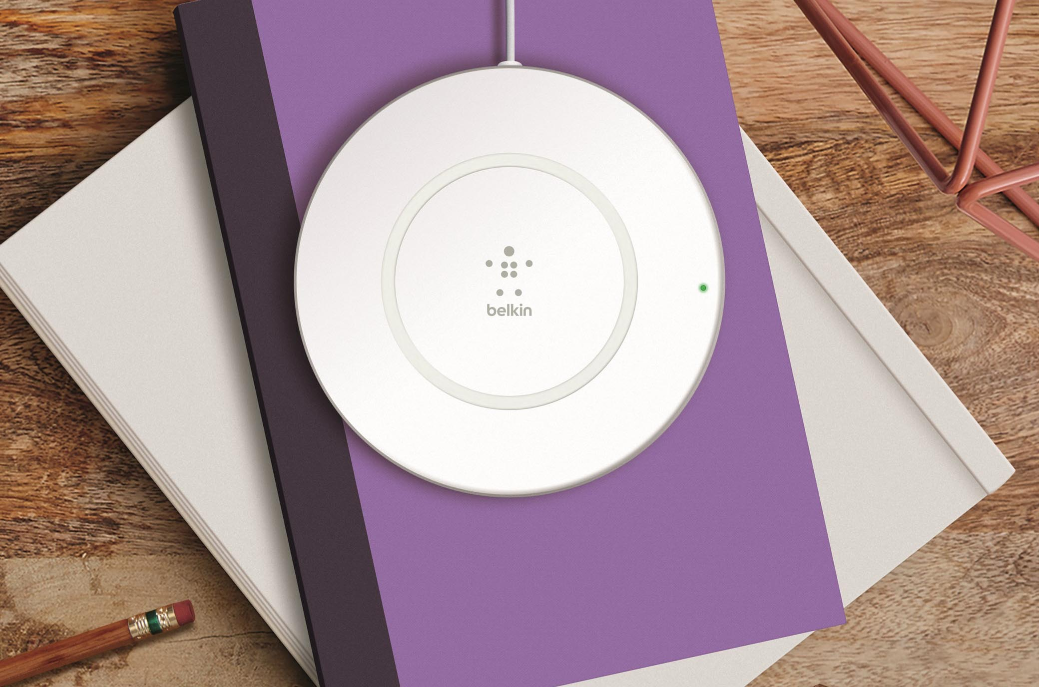 BOOST↑UP Charging Pad on purple notebook