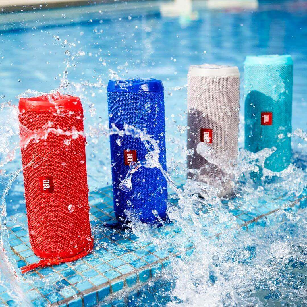 JBL Flip 4 Speakers on the Side of the Pool Getting Wet