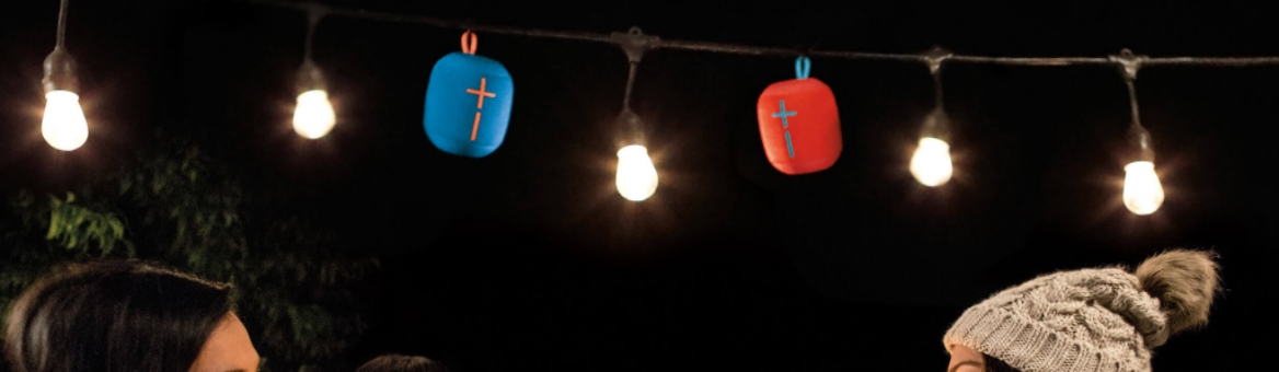 Ultimate Ears Wonderboom Speakers Hanging From a String of Lights Outside