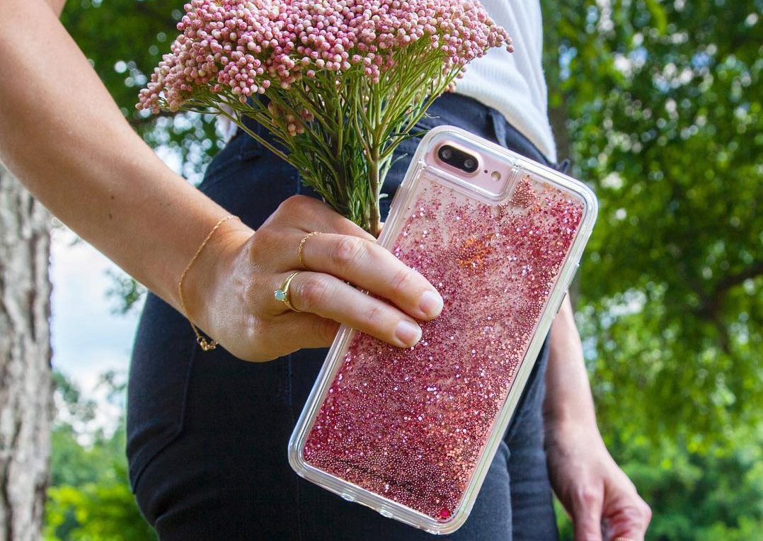 Woman holding flowers and Case-Mate Waterfall case