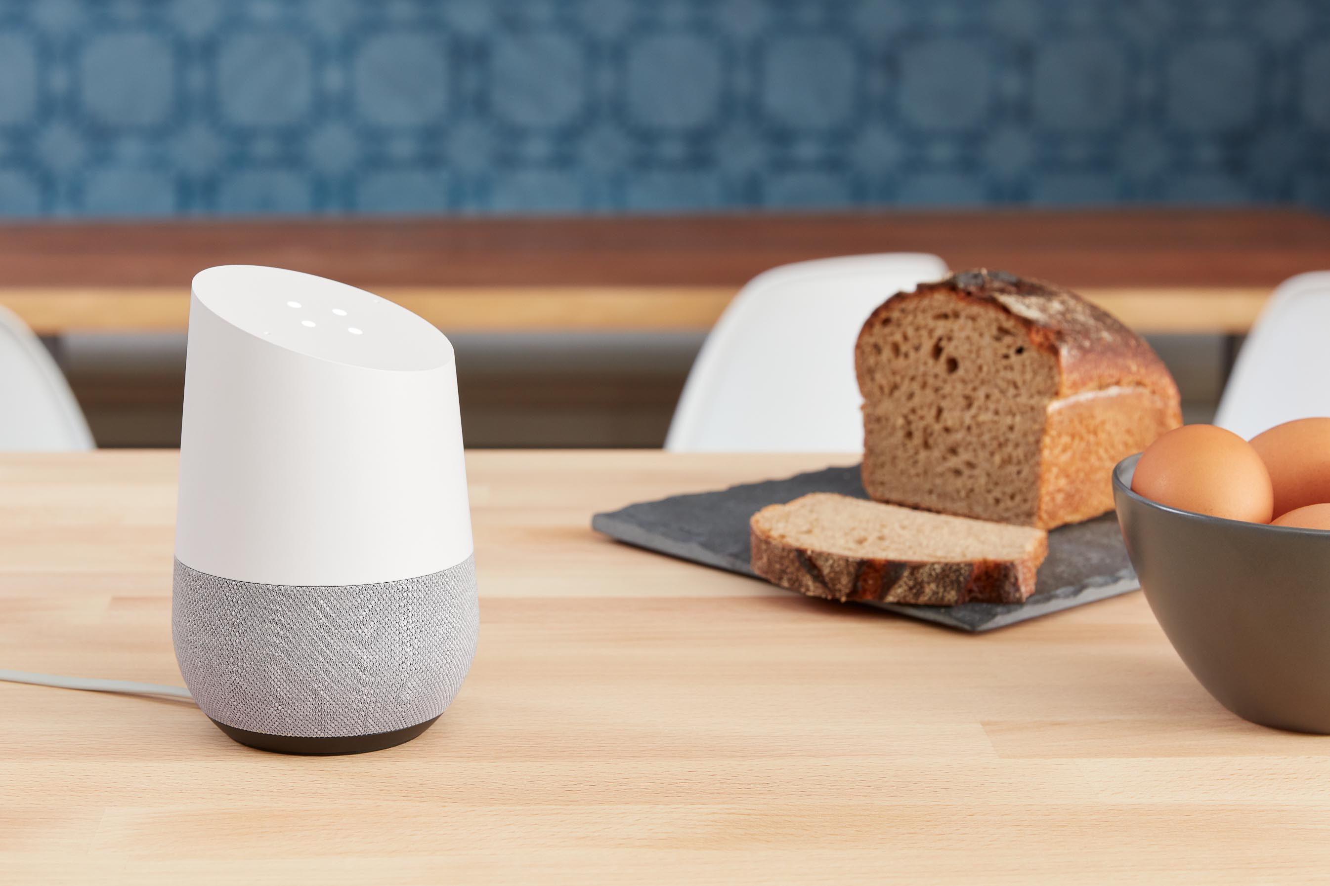 Chalk Google Home on Kitchen Table Beside Bread and Eggs