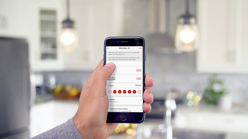 Person using Sengled app to set a lighting schedule